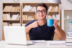 The young student drinking coffee from cup Stock Image