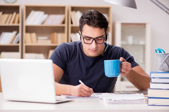 The young student drinking coffee from cup Stock Photos