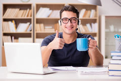 The young student drinking coffee from cup Royalty Free Stock Photos
