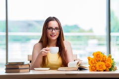 The young student drinking coffee while sudying Royalty Free Stock Photos