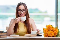 The young student drinking coffee while sudying Royalty Free Stock Images
