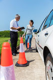 Young student driver instructor. Young student driver and instructor doing pre test inspection stock photo