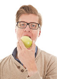 Young student eating an apple Royalty Free Stock Images