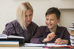 Young student engaged in the lessons with his teacher. Helping. Royalty Free Stock Photography