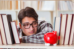 The young student in expensive textbooks concept Royalty Free Stock Photography