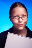 Young student in eyeglasses holds folder and smiling Stock Photos