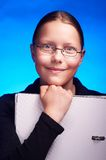 Young student in eyeglasses holds folder and smiling Royalty Free Stock Photography