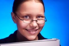 Young student in eyeglasses holds folder and smiling Stock Photo