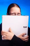 Young student in eyeglasses holds folder and smiling Royalty Free Stock Images
