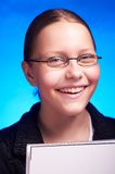 Young student in eyeglasses holds folder and smiling Stock Photography