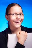 Young student in eyeglasses holds folder and smiling royalty free stock image