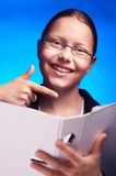 Young student in eyeglasses shows on folder with finger Stock Photo