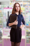 Young student with folder in her hand in pharmacy Stock Photos
