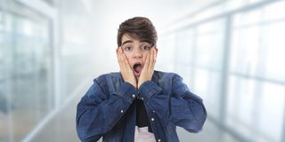 Young student with fright or surprise. Expression royalty free stock photography
