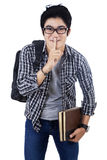 Young student gesturing for quiet Royalty Free Stock Image