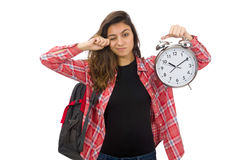 The young student girl with alarm clock Royalty Free Stock Photos