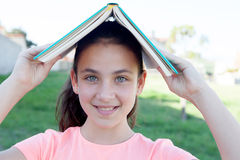 Young student girl with a book on the head Stock Image