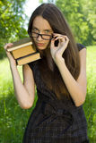 Young student girl with books in the park. Happy young student girl with books in the park Royalty Free Stock Images