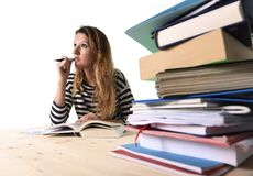 Young student girl concentrated studying for exam at college library education concept Stock Photos