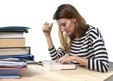 Young student girl concentrated studying for exam at college library education concept Royalty Free Stock Image
