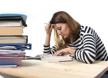 Young student girl concentrated studying for exam at college library education concept Stock Photo