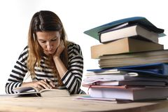 Young student girl concentrated studying for exam at college library education concept. Young student girl concentrated studying with textbook at college library Stock Photos