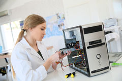 Young student girl fixing hard drive Royalty Free Stock Images