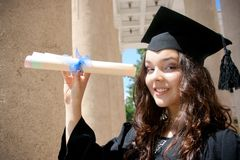 Young student girl in gown Royalty Free Stock Image