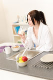Young student girl have breakfast in kitchen Royalty Free Stock Image