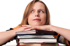 Young student girl with head on top of books pile Royalty Free Stock Images