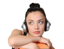 Young student girl with headphones with books. On white background Royalty Free Stock Photo