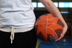 Young student girl is holding a basketball  Stock Images