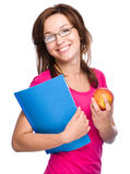 Young student girl is holding book and apple Stock Image