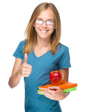 Young student girl is holding book and apple Royalty Free Stock Photos