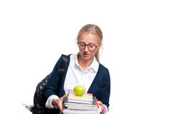 Young student girl holding books. Back to school. Young student girl holding books, high school or college graduand, standing isolated on white background. Back Stock Photo