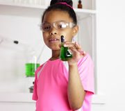 I want to be a scientist. Young student girl holding a small flask who wants to be a successful scientist or chemist Stock Image