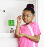 This is my future job - copyspace. Young student girl holding thermometer in science class.  Could be expressing desire to enter the science or chemistry career Stock Photos