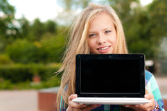 Young student girl with laptop Royalty Free Stock Images