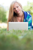 Young student girl with laptop Stock Image