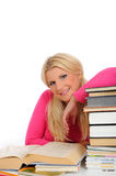 Young student girl with lots of books Royalty Free Stock Photography