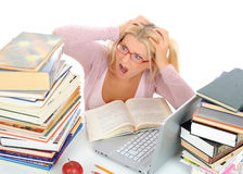 Young student girl with lots of books in panic. Stock Photos