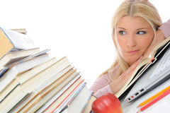 Young student girl with lots of books in panic Royalty Free Stock Photos