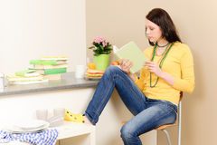 Young student girl reading book at home. Young student girl reading book in student apartment Royalty Free Stock Images