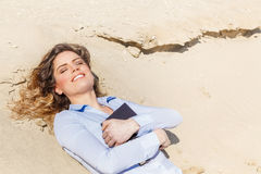 Young student girl relaxing on the beach Stock Images