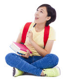 Young student girl sitting on floor with book Stock Images