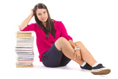 Young student girl with stack of books on white Stock Image