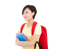 Young student girl standing and holding book Royalty Free Stock Photography