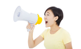 Young student girl standing and holding megaphone Stock Image