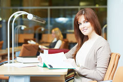 Young student girl study with book in library Royalty Free Stock Photos