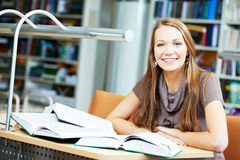 Young student girl study with book in library Royalty Free Stock Image